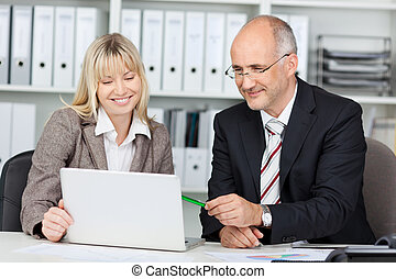 businesswoman present at laptop
