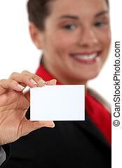 Businesswoman presenting card