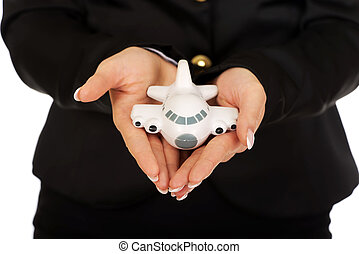 Businesswoman presenting plane model in hand