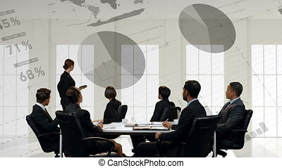 Businesswoman presenting to a group of business people