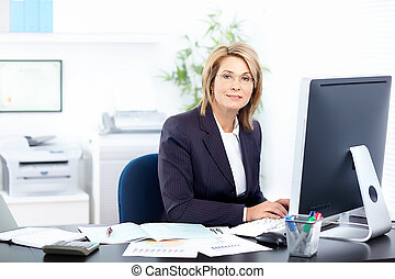 businesswoman - Pretty business woman working in the office