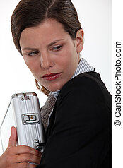 Businesswoman protecting a briefcase