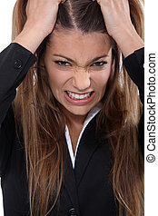 Businesswoman pulling hair out