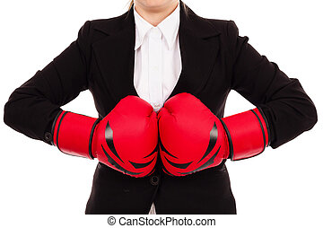 Businesswoman punching red boxing gloves together ready to...
