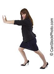 Businesswoman Pushing - young female entepreneur pushing or...
