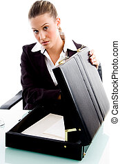 businesswoman putting document in briefcase