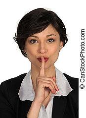 Businesswoman quiet gesture