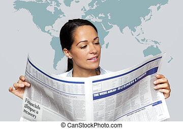 Businesswoman reading a financial newspaper