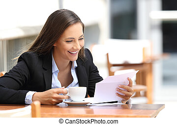 Businesswoman reading a letter in a coffee shop - Single ...