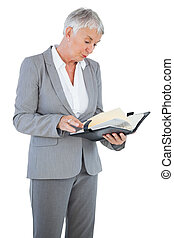 Businesswoman reading her diary