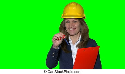 businesswoman real estate agent with helmet hold and give...