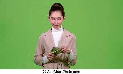 Businesswoman received paper money for a major deal. Green screen