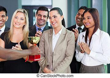 businesswoman receiving a trophy