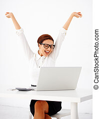 Businesswoman rejoicing - Beautiful young businesswoman...