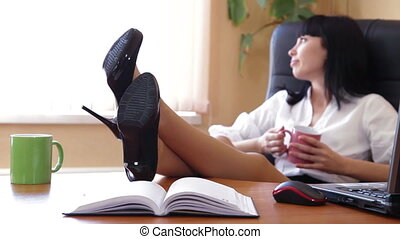 Businesswoman Relaxing In The Office Focus On Shoes