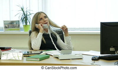 Businesswoman relaxing in the office  talking on the phone