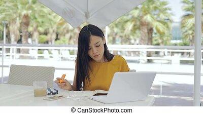 Businesswoman relaxing on terrace