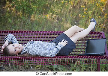 woman relaxing on the bench