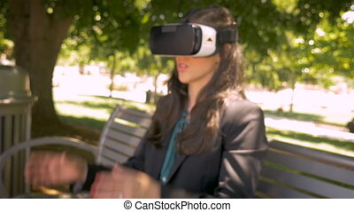 Businesswoman removing her VR headset disappointed to enter the real world