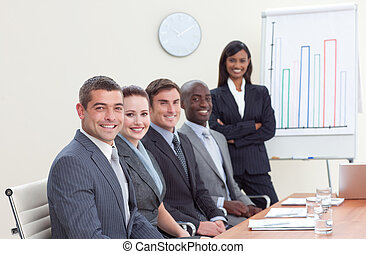 Businesswoman reporting to sales figures to her colleagues