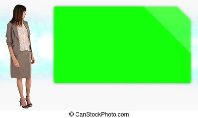 Businesswoman revealing chroma key space on white background