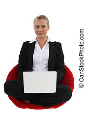 Businesswoman sat cross-legged