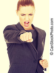 Businesswoman screaming and shaking her fist.