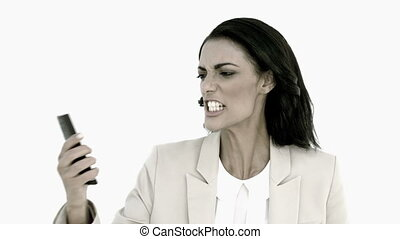 Businesswoman screaming down her mobile phone in black and...