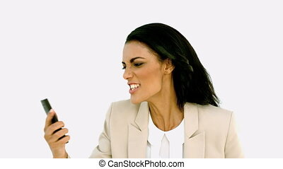 Businesswoman screaming down her mobile phone in slow motion