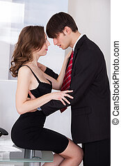 Businesswoman Seducing Boss In Office - Young businesswoman...