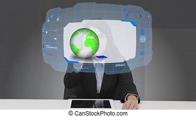 Businesswoman selecting futuristic interface with her finger