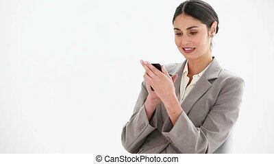 Businesswoman sending a text message