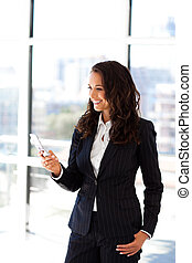 Businesswoman sending a text