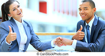Businesswoman shaking hand to partner with succesful deal