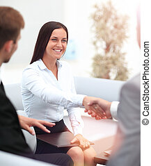 Businesswoman shaking hands to seal a deal with her partner