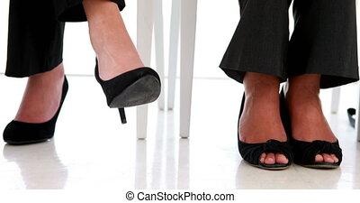 Businesswoman shaking her feet
