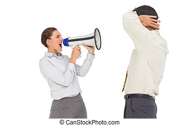 Businesswoman shouting at businessman with megaphone