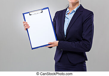 Businesswoman show with blank clipboard