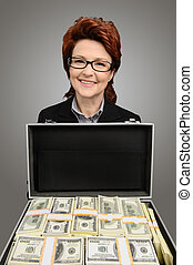 Businesswoman showing a briefcase full of money - isolated