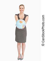 Businesswoman showing a globe