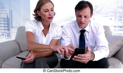 Businesswoman showing colleague how