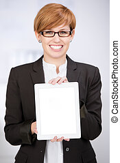 Businesswoman Showing Digital Tablet In Office