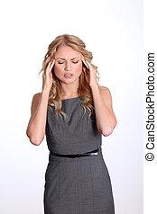 Businesswoman showing migraine pain