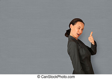 Businesswoman showing thumb up