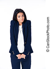 Businesswoman shrugging her shoulders over white background...