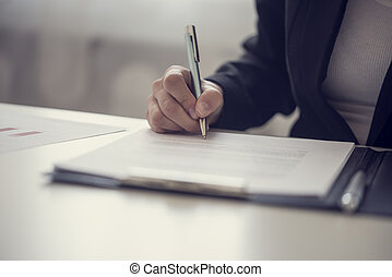 Businesswoman signing a contract or document