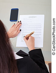 Businesswoman Signing Contract Papers