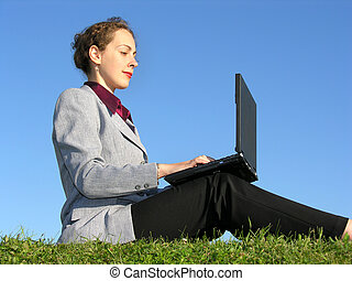 businesswoman sit with notebook on blue sky 2