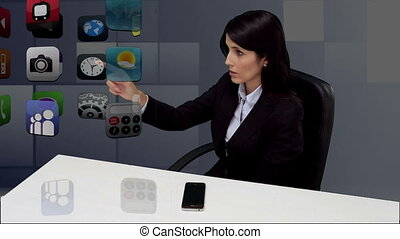 Businesswoman sitting at desk and s