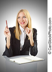 Businesswoman sitting at the desk